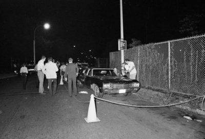 Police investigate the scene of Donna Lauria (18) and Jody Valenti (19) murders