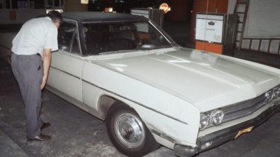 Detectives examining Berkowitz car on Aug. 11, 1977