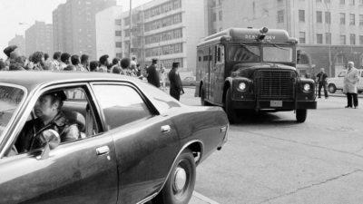 Police escort Berkowitz van as it arrives outside Brooklyn court on May 8, 1978