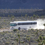 Unmarked white bus photographed entering Area 51