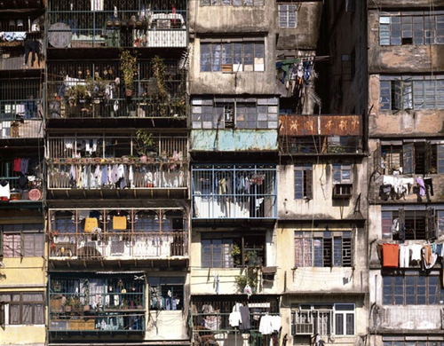 Clothing hangs from Kowloon Walled City balconies