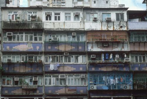 Kowloon Walled City balconies overlooking the street