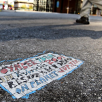Toynbee tile in middle of street