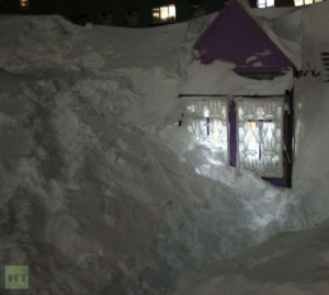 Snow cleared around a home in Russia