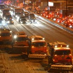 Russian city workers clear streets of snow