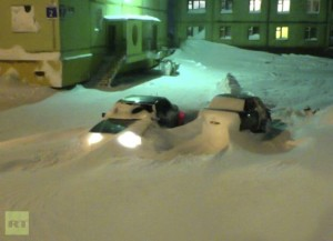 Cars buried under snow in Russia