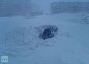 Car buried under snow in Russia