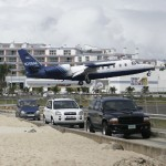 Cars stop to let low-flying airplane land