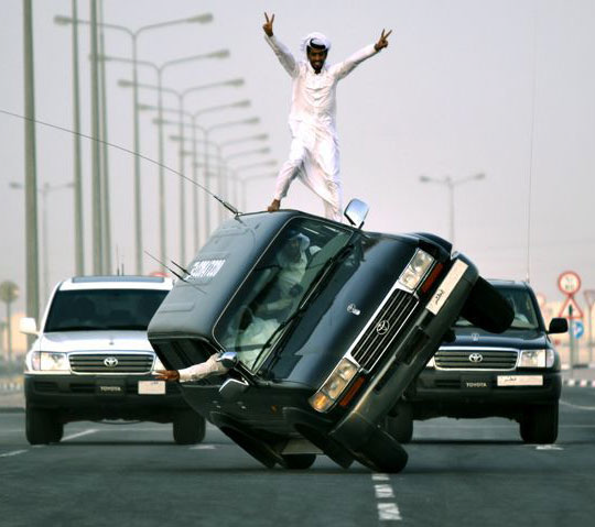 Saudi Arabia Sidewall Skiiing - youth's newest dangerous fad involves driving car on two wheels