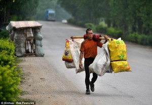 Lingchao sets his home by the side of the road while he walks to deposit trash