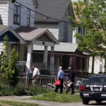 Police searching the scene of the Ohio kidnapping home