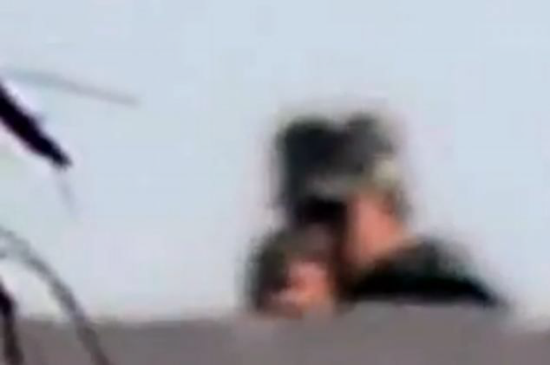 Egyptian sniper photographed at the moment he pulled the trigger killing the photographer
