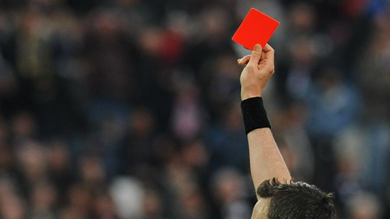Referee issues red card in soccer game