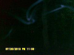 Strange ghostly blue mist filmed in vacant lot next to the haunted home
