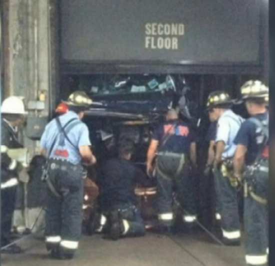 New York worker drives car into empty elevator shaft