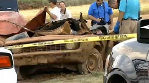 Police examine the 1969 Camaro found at the bottom of Foss Lake