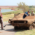 Police examine the 1969 Camaro found at the bottom of Foss Lake