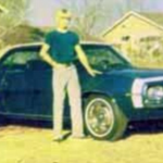 Jimmy standing next to his brand new blue 1969 Camaro