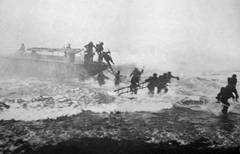 Mad Jack Churchill storming the beach with sword in hand (right side of photo)