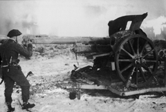 Mad Jack Churchill peering down the barrel of an enemy cannon
