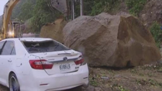 Mudslide and massive boulder that narrowly missed passing car thumb