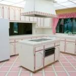 Pink trim decorate this 70's era kitchen