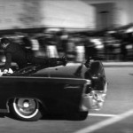 Secret Service Agent Clint Hill clings to limo as Kennedy is rushed to Parkland Hospital