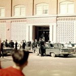 Police congregate in front of the Texas School Book Depository after the assassination