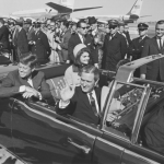 JFK and Jackie in limo about to leave Love Field in Dallas