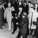 Photo showing Ruby approaching Oswald with gun in hand