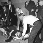 Lee Harvey Oswald on a stretcher after being shot by Jack Ruby