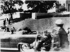 The grassy knoll and fence moments after Kennedy was shot