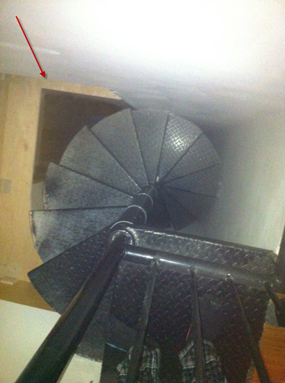 The spiral staircase seemed to lead to nowhere but notice the small crawl-space as indicated by the arrow in the photo