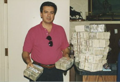 Archie Karas shows off his winnings