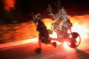 Krampus driving a fiery chariot