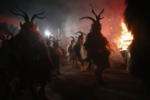 Army of Krampus creatures march down the street during the annual celebration