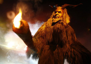 Krampus carrying a lit torch for added effect