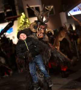 Krampus carrying away a naughty child
