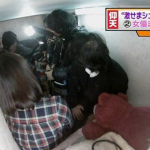 Reports crowd to film a coffin apartment in Hong Kong
