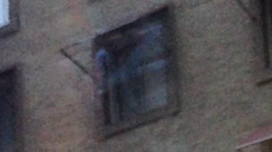 Photo of ghost emerging from window of Cecil Hotel in Los Angeles, California