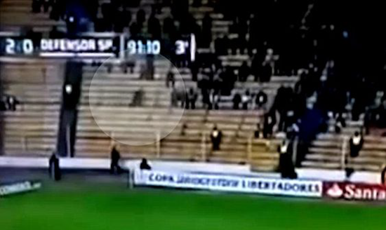 Strange smoky ghostly figure captured on video gliding through stands during Bolivian soccer game