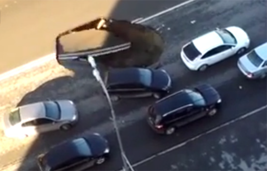 Sinkhole in Russian highway nearly swallows passing cars