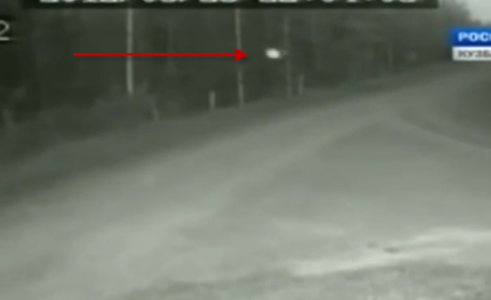 White orb UFO caught travelling down darkened road in Russia
