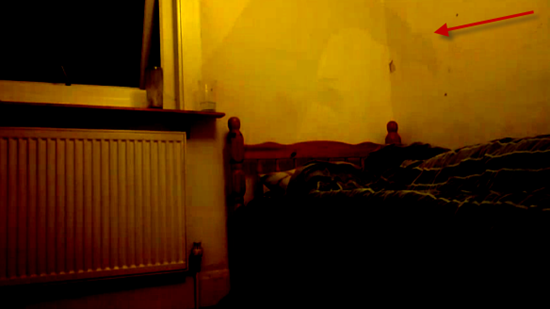 Man suffering from sleep paralysis videos smoky black figure rising from bed