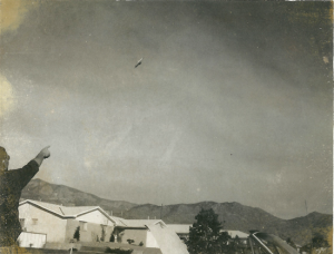 Photograph circa-1962 of disc-shaped UFO near Kirkland Air Force Base in Albuquerque, New Mexico (Sandia Mountains clearly visible in background)