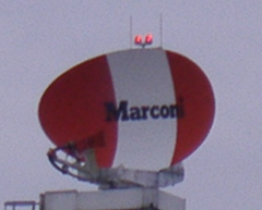 Satellite dish with Marconi corporate logo