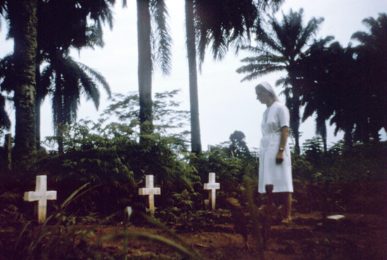 A nun viewing the graves of Ebola victims in Zaire