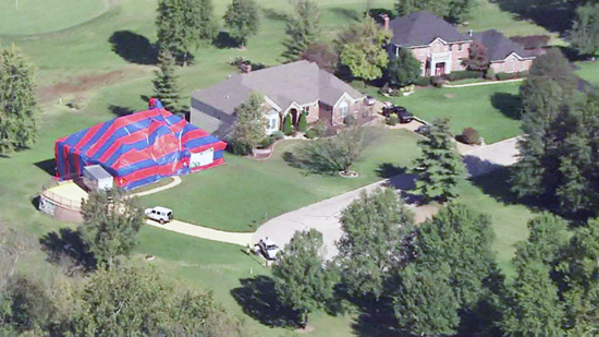 Missouri home infested with brown recluse spiders is covered with tarp and pumped full of poison
