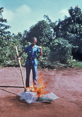 Health care worker incinerating materials used in the treatment of Ebola patients at a Yambuku hospital in 1976