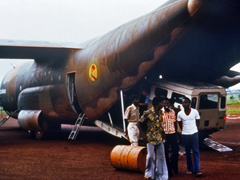 Scientists arrive by cargo plane with Land Rover vehicle used to travel through the Ebola-infected area